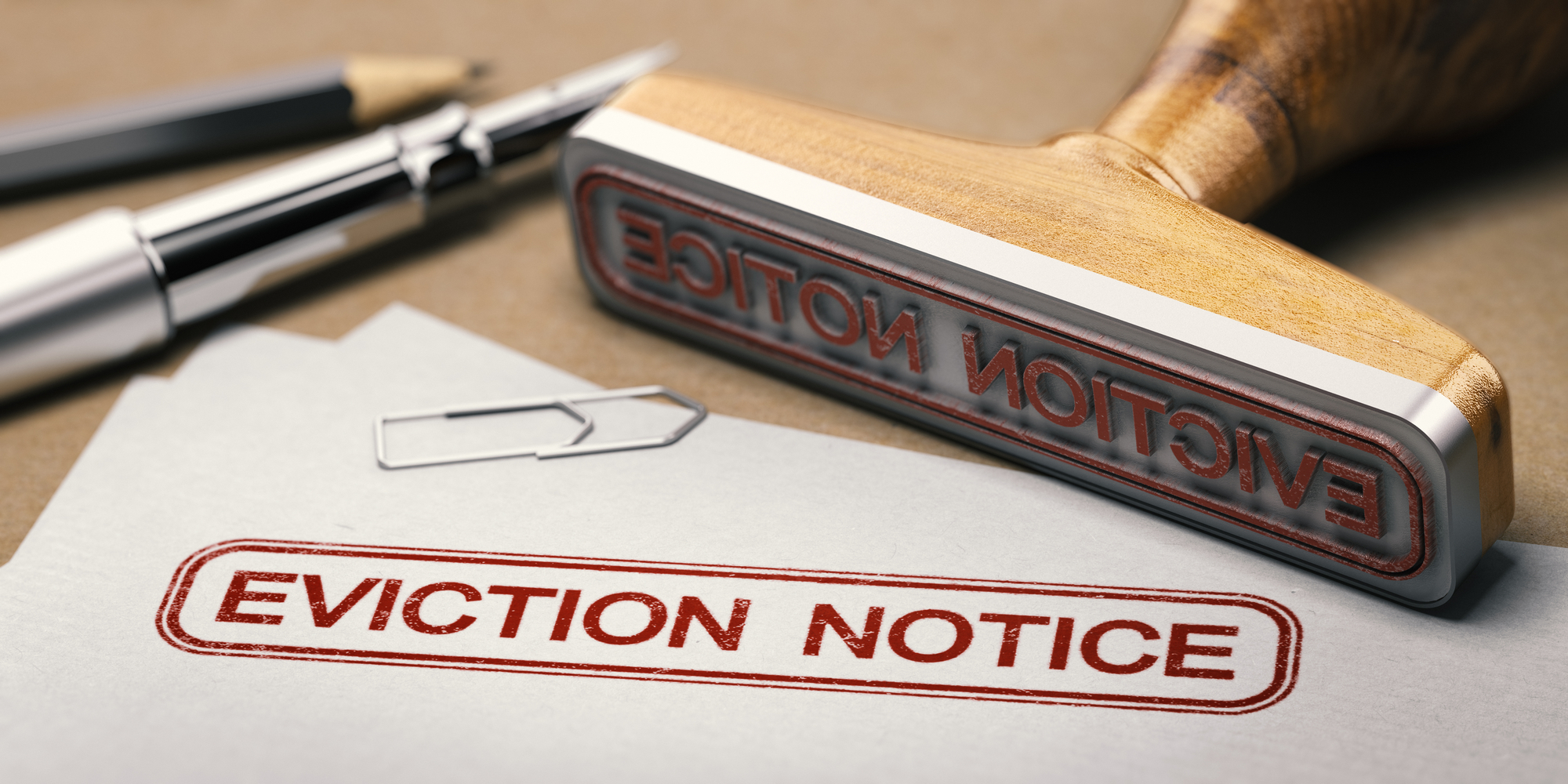 3D illustration of a rubber stamp with the text eviction notice printed on a document