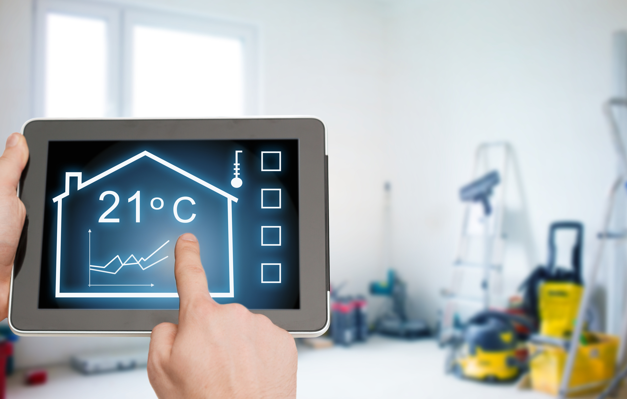 Close up of tablet pc in hands setting temperature