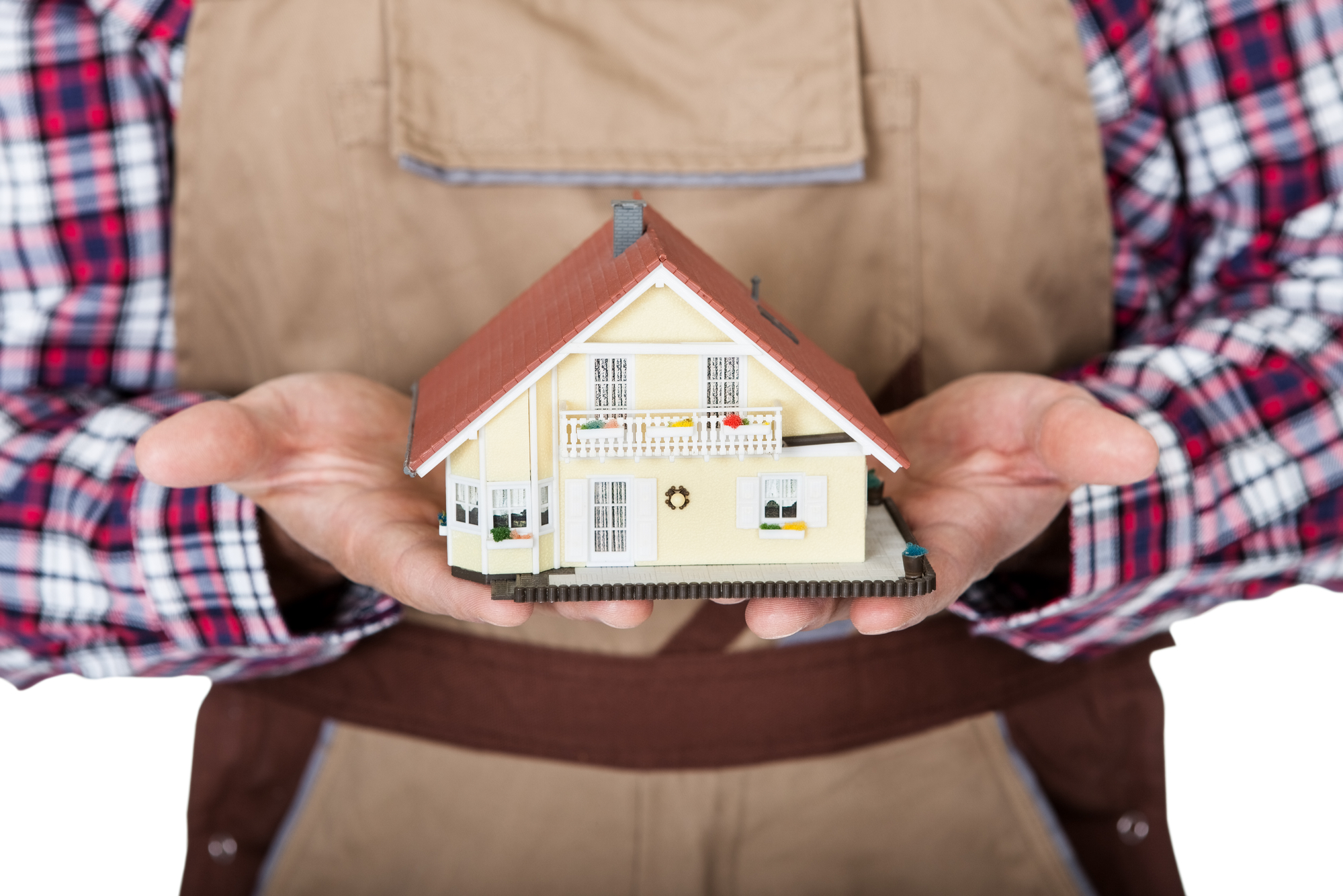 Construction worker holding house model