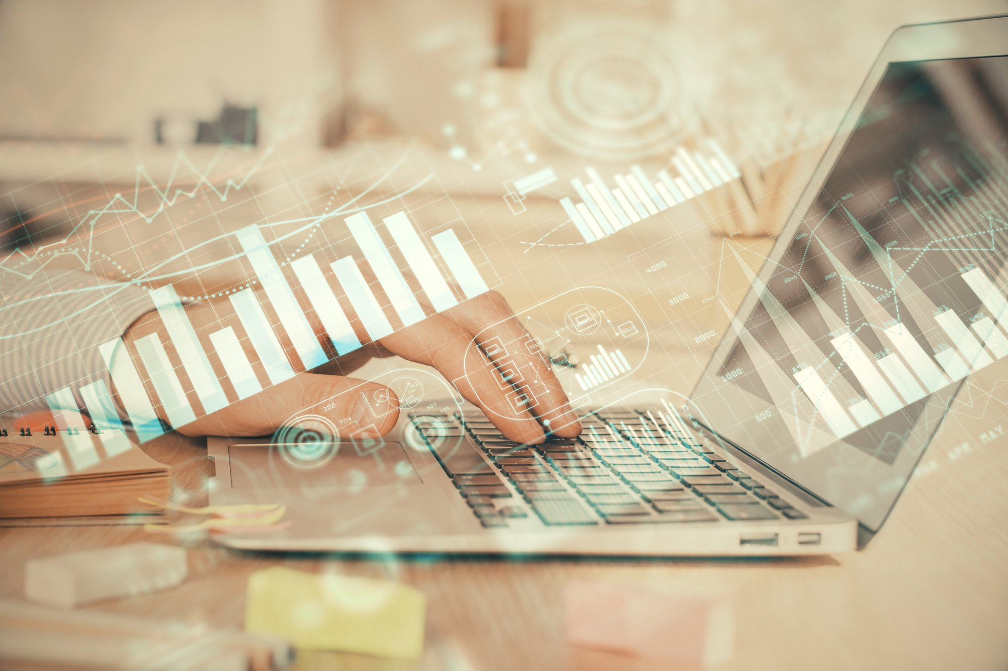 Double exposure of stock market graph with man working on laptop on background. Concept of financial analysis