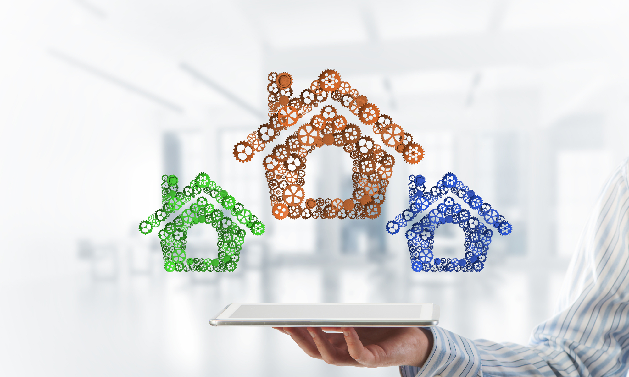 Real estate or construction idea presented by home icon on tablet pc