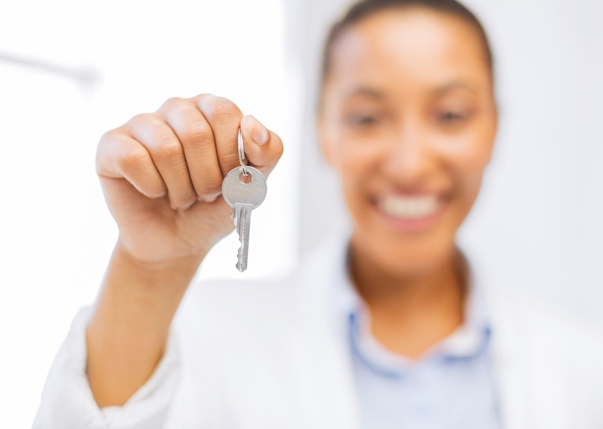 Woman hand holding house keys